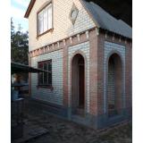 Дом с мансардой,стены из газоблока,обложен кирпичем,без внутренних работ.